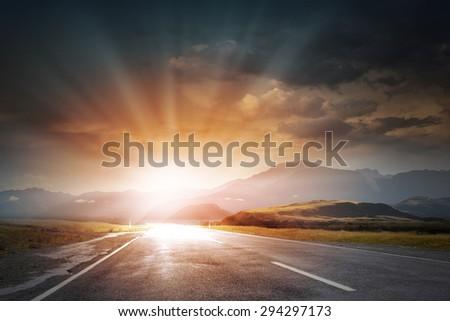 Nature landscape of sunset light above asphalt road #294297173