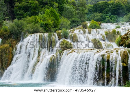 Nature landscape of waterfall cascade in the Croatia. Krka river waterfall is popular travel place in Europe. Beautiful Skradinski Buk Waterfall In Krka National Park