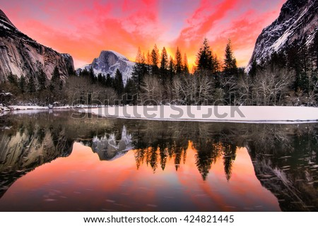 Stock Photo Nature Landscape of Yosemite National Park, California, USA.Yosemite National Park is in Sierra Nevada Area.In this landscape picture, you can see Half Dome, reflection, sunrise, and colorful sky