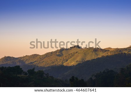 Nature Landscape, View Mountain have a haft light and is a light on morning, background sky on morning have a two tone color blue and orange.