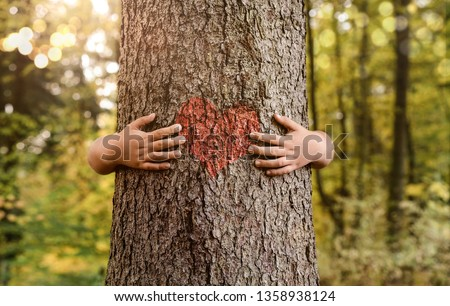 Nature lover, close up of child hands hugging tree with copy space #1358938124