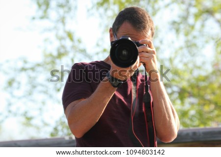 nature photographer taking a picture #1094803142