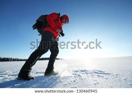 Nature photographer trekking in winter conditions