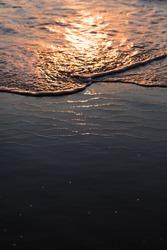 nature poster. surf ocean. splah of wave at orange sunset. boke of water drops