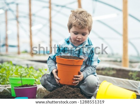 nature protection. nature protection concept. small kid love nature protection. nature protection by seeding and planting trees. everything grows with love #1288551319