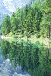 Nature reserve in the Dolomites in South Tyrol, Italy .Fanes-Sennes-Prags Nature Park . UNESCO World Heritage Dolomites . People walking along Pragser Wildsee lake