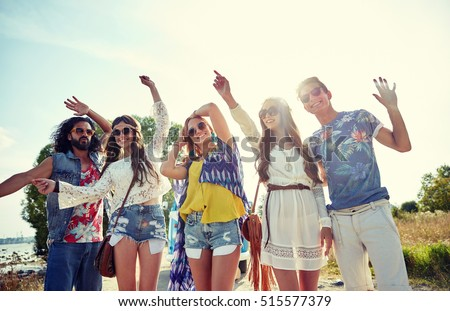 nature, summer, youth culture and people concept - happy young hippie friends dancing outdoors #515577379