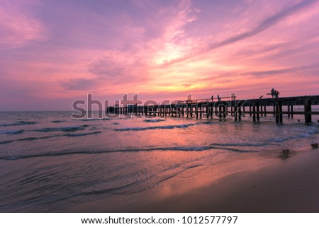 nature twilight / The wooden bridge pier in the morning sun light or light evening on the beach in the country, Thailand.  #1012577797
