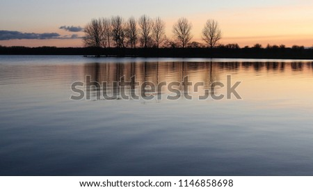 Natures own watercolour, reflected on the waters of Rutland, England. As the sun set, gradually its light was able to gently and softly, produce this image like an oil paining, but through the lens. #1146858698