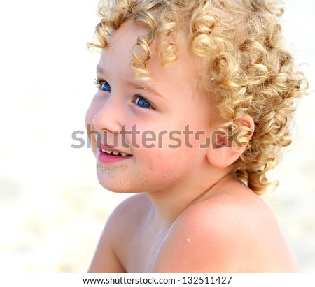 Naughty blond boy on the coast of the Black Sea