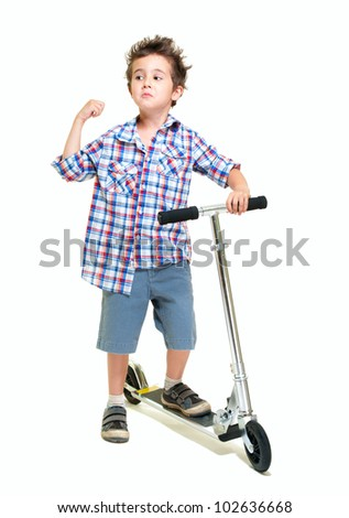 Naughty hairy little boy in shorts and shirt with scooter isolated on white
