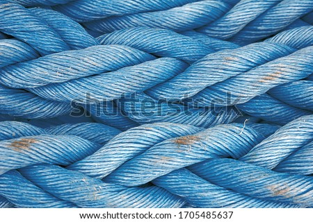 Nautical background. Old blue frayed ship rope closeup. Classic blue texture. Foto d'archivio ©