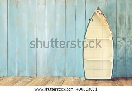 nautical boat shape shelves on wooden table. product display background, vintage filtered