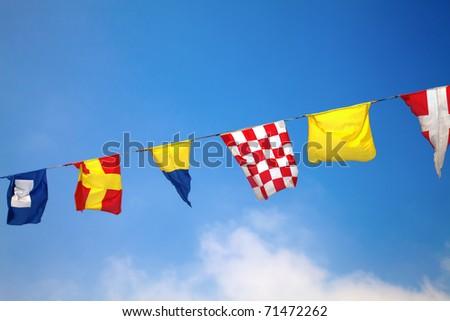 Nautical flags against blue sky #71472262