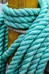 Nautical rope draped around wood post on sailing ship at Tall Ships Festival on Lake Erie in Cleveland