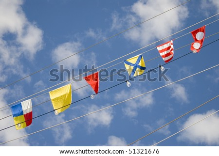 nautical signal flags in the sky