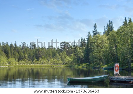 Nautical vessels for fishing in the forest nature lake with blue sky. Travel off the beaten path