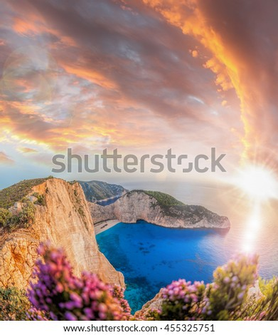 Navagio beach with shipwreck and flowers against sunset on Zakynthos island in Greece #455325751