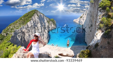 Navagio beach with woman on cliff, Zakynthos Island, Greece - stock photo
