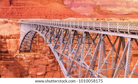 Navajo Bridge spanning the Colorado River in Arizona at Marble Canyon, mile one of the Grand Canyon