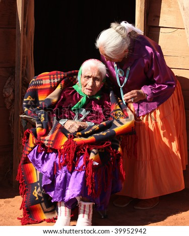 Navajo Family of 2 Women Outdoors in Front of Family Hogan