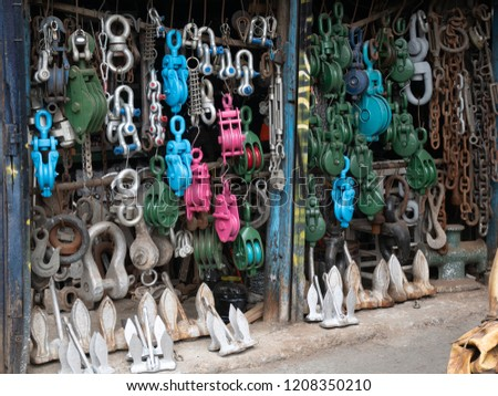 naval marine store, bazaar, market with various vessel equipment, stuff, gear for sale - anchors, shackles, tackles, rigging, chains cordage hooks