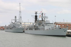 Naval ships in Portsmouth dockyard, England
