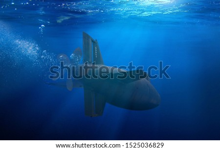 Photo of  Naval submarine on a mission travelling under water