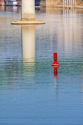 Navigation Buoy Red Mark Near Bridge Pillar in River