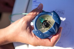 Navigation compass in the hand of the yacht's captain