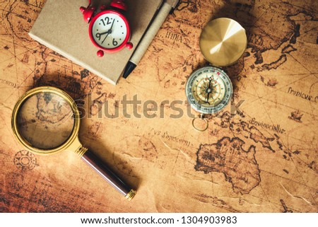 Navigation explore journey planning with compass magnifying glass and pocket watch layout on world map background., Expeditions investigate of treasure or travel destination concept.