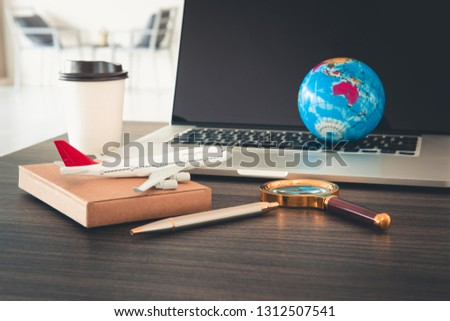 Navigation explore of journey planning., Travel destination and expedition plan vacation trip., Close up of layout magnifying glass, calendar, compass, airplane model and global model on the table.