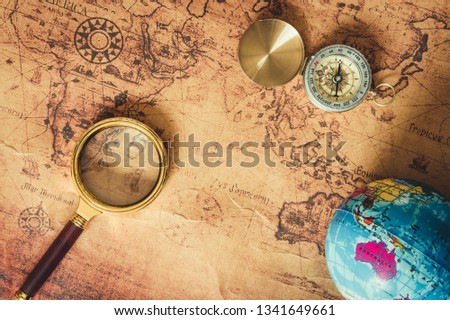 Navigation Explore of Journey Planning., Travel Destination and Expedition Plan Vacation trip., Close Up of Layout Magnifying Glass, Compass, Global Model on The World Map Background.