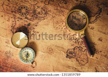 Navigation Explore of Journey Planning., Travel Destination and Expedition Plan Vacation trip., Close Up of Layout Magnifying Glass, Compass on The World Map Background.