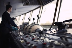 Navigation officer driving the ship on the river. Color corrected in film tones