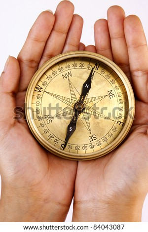 Navigational compass in the hands