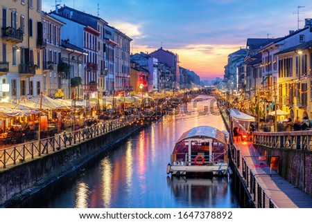 Photo of  Naviglio Grande canal in Milan city, Italy, a popular tourist area, on dramatic sunset