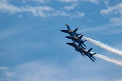 Navy Blue Angels formation with smoke