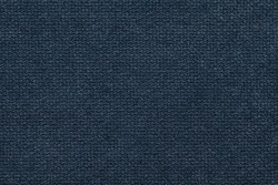 Navy blue background of soft, fleecy cloth. Texture of light dark denim nappy textile, closeup.