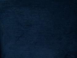 Navy blue background, Texture of dark blue plush fabric, dense velvet. Soft, fleecy cloth. Texture of dark denim nappy textile, closeup, vintage