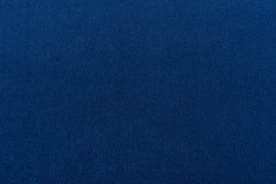 Navy blue dark fabric texture background top view banner. Classic blue cloth empty canvas, seamless casual fashion clothes material, flat lay wallpaper or banner of vibrant blue surface