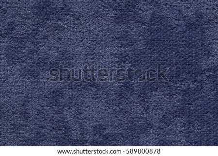 Navy blue fluffy background of soft, fleecy cloth. Texture of textile closeup. #589800878