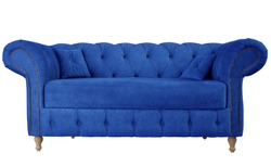Navy blue sofa with pillows on wooden legs isolated on white. Darck blue suede couch isolated