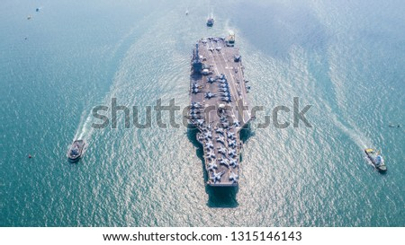 Navy Nuclear Aircraft carrier, Military navy ship carrier full loading fighter jet aircraft, Aerial view. #1315146143