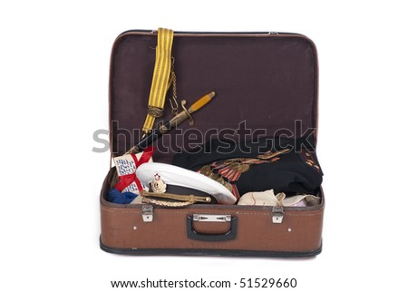 Navy officer's coat with military medals in an old suitcase