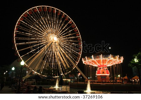 Navy Pier amusement park with rides at night in Chicago