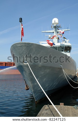 Navy warship frigate anchored in a base port - stock photo