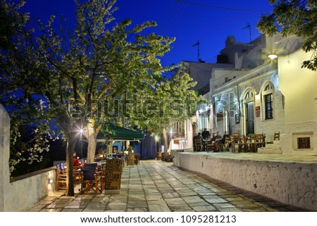 "NAXOS ISLAND, CYCLADES, AEGEAN SEA, GREECE- May 3, 2012. The central alley of Apiranthos (or ""Apeiranthos""), one of the most beautiful mountainous villages of the island."