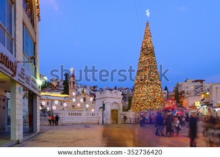 NAZARETH, ISRAEL - DECEMBER 16, 2015: Christmas scene of Mary Well square, with the Greek Orthodox Church of the Annunciation, a Christmas tree, locals and tourists, in Nazareth, Israel