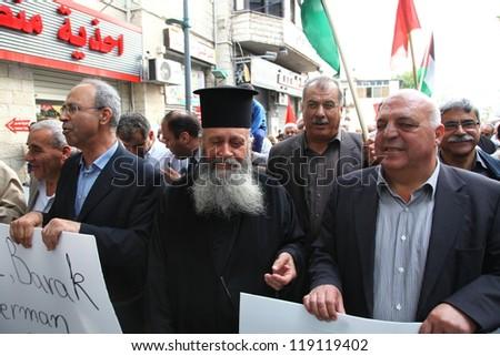 NAZARETH, ISRAEL - NOVEMBER 17: Arab Muslim Knesset Members and priest father Saleh Khoury lead march of Israelis in anti war demonstration supporting Gaza in Nazareth Israel, November 17,2012